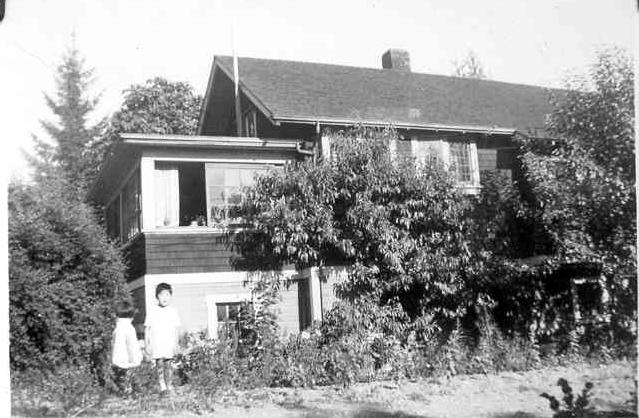 Joy and her brother Timothy at the house, c. 1938