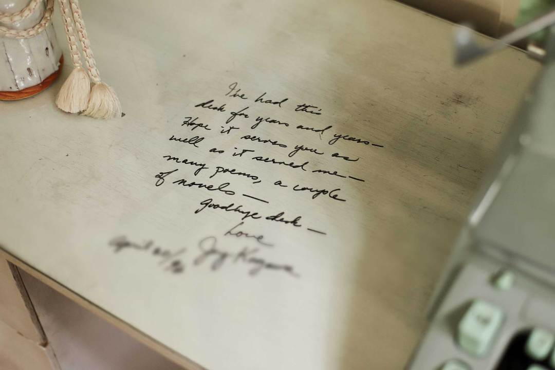 """The inscription reads, """"I've had this desk for years and years – hope it serves you as well as it served me – many poems, a couple of novels – goodbye desk – Love, Joy Kogawa April 20/96"""""""