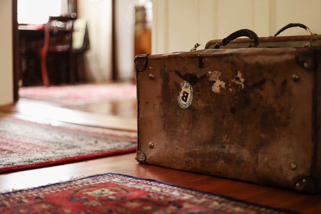 Detail of a display at Historic Joy Kogawa House: the suitcases are a physical reminder of the forcible removal of Japanese Canadians from their homes.