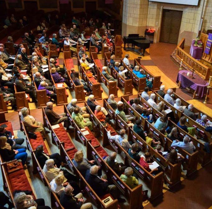 picture of people sitting in pews during a worship service