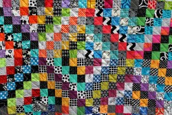 Multi-color quilt with small squares