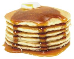 stack of pancakes covered with butter and syrup