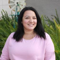 Jennifer wearing pink blouse
