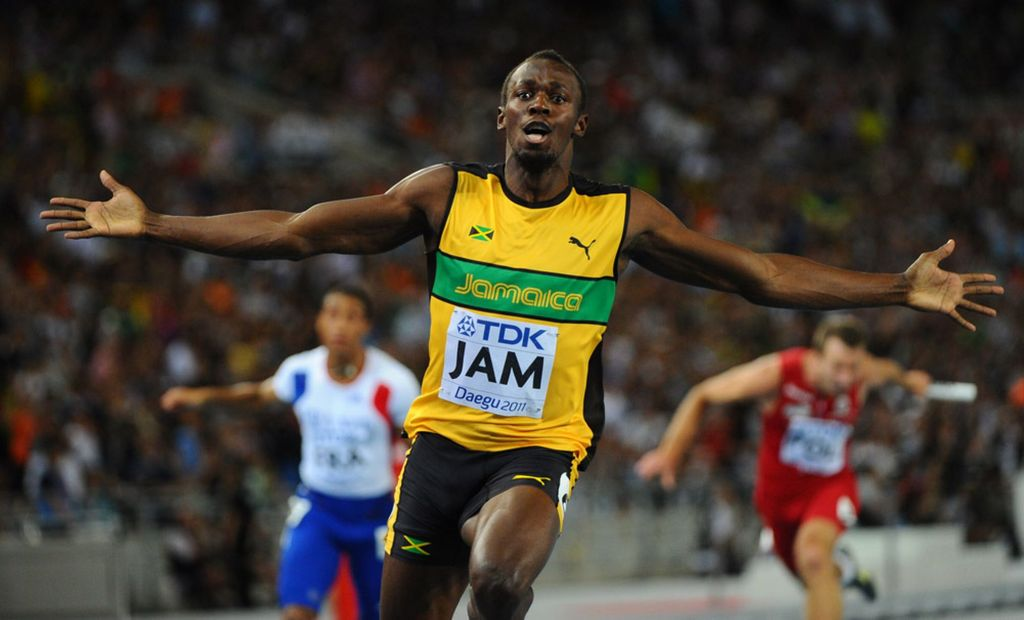 Jamaica's Usain Bolt wins the men's 4x100 metres relay final to set a new world record