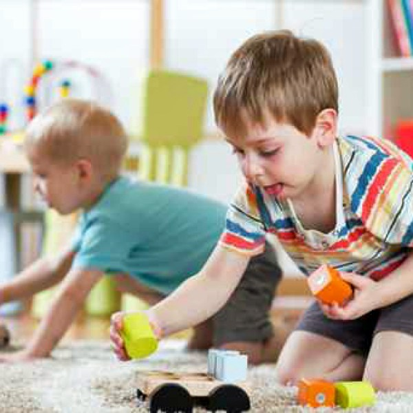 Children playing with toys in kindergarten or daycare or home_294806