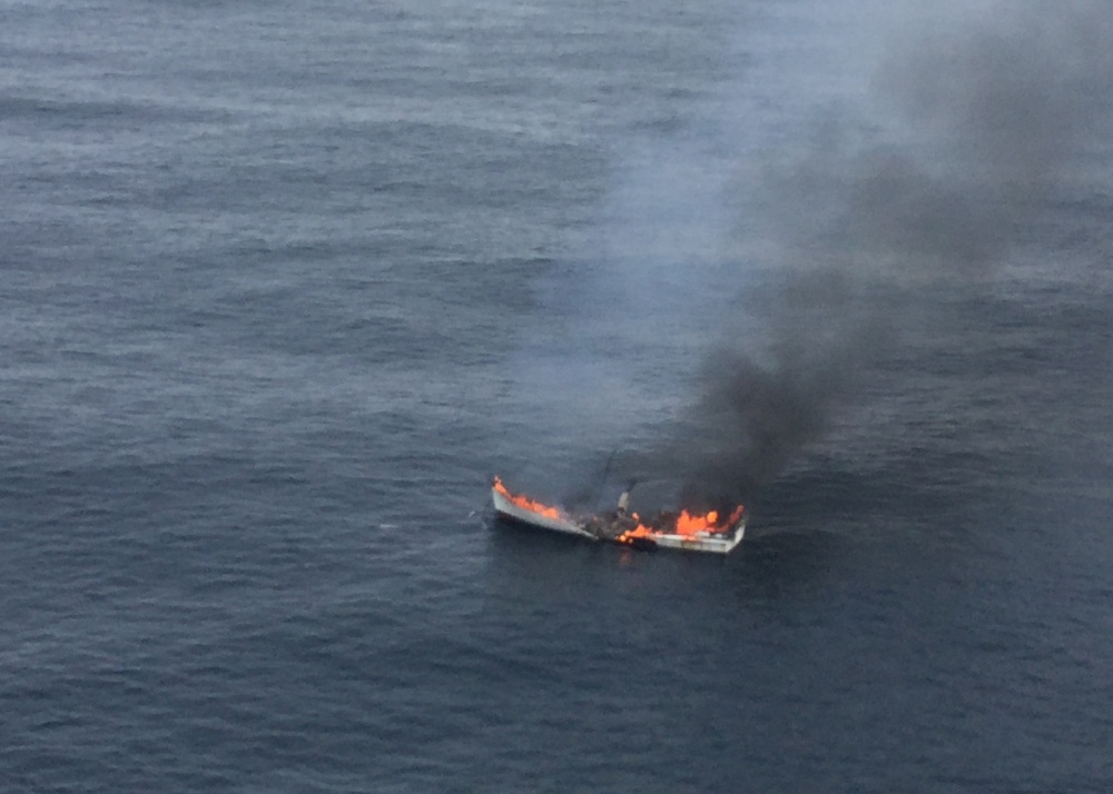 The 47-foot fishing vessel is engulfed in flames after it caught fire 20 miles west of the Cape Blanco light near Coos Bay, Ore., Aug. 5, 2017._500657