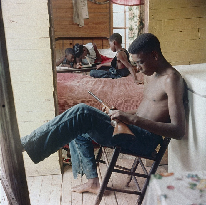 Willie Causey, Jr., with Gun During Violence in Alabama, Shady Grove, Alabama 1956. Gordon Parks (American, 1912-2006). Collection of The Gordon Parks Foundation