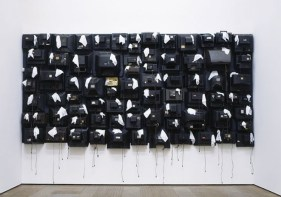 Nari Ward, Airplane Tears, 2005. Found television backs and napkins Dimensions variable. Image courtesy the artist and Lehmann Maupin, New York, and Hong Kong.