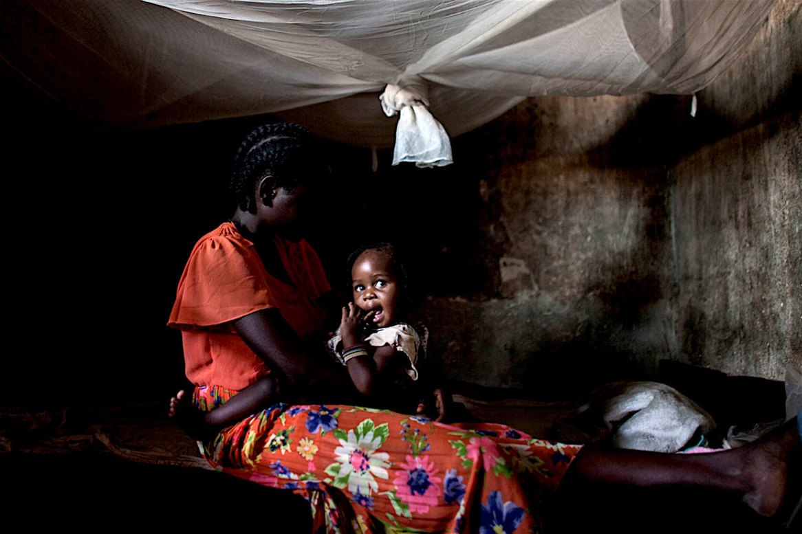 Bangui, CAR- A young woman, holding her 1-year-old daughter, says that when she was 17, a peacekeeper from the Republic of the Congo coerced her into having sex for money and food, leaving her pregnant. (By: Jane Hahn)