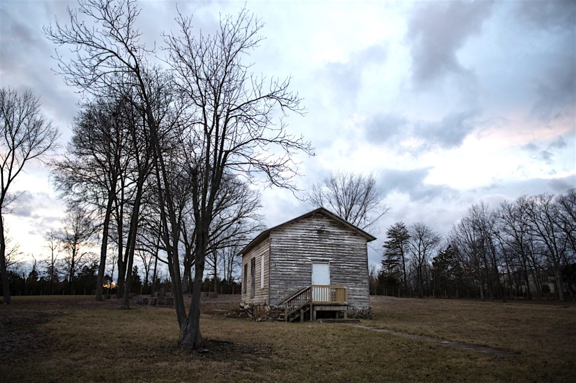 A group of Loudoun School for the Gifted students are organizing to preserve the Ashburn Old School, a school for black children which operated from the late 1890's until the late 1950s, on Feb. 25 in Ashburn, Va (Kate Patterson/For The Washington Post)