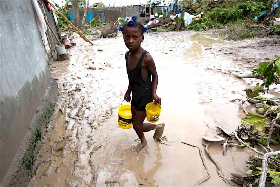 A girl lugs buckets of drinking water after the passing of Hurricane Matthew in Les Cayes, Haiti, Thursday, Oct. 6, 2016. Two days after the storm rampaged across the country's remote southwestern peninsula, authorities and aid workers still lack a clear picture of what they fear is the country's biggest disaster in years. (AP Photo/Dieu Nalio Chery)