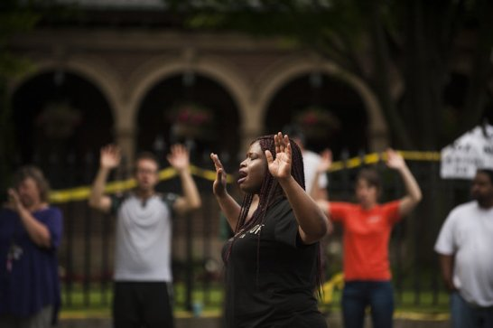 """Protesters chanted """"Hands up, don't shoot"""" outside of the governor's mansion in St. Paul on Thursday after the fatal police shooting of Philando Castile. Credit Stephen Maturen/Getty Images"""