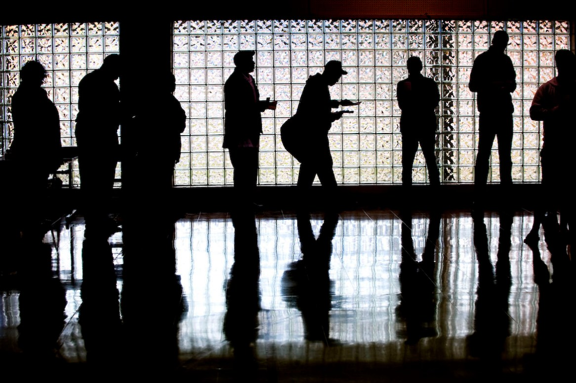 CHARLOTTE, NC - NOVEMBER 4: Voters line up to cast their ballots at First Ward Elementary School, Precint 13, in Charlotte, N.C., on election day, Nov. 4, 2008. Voting is underway in the U.S. presidential elections with Democratic presidential nominee Sen. Barack Obama (D-IL) leading in the polls against the Republican presidential nominee Sen. John McCain (R-AZ). (Photo by Davis Turner/Getty Images)