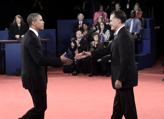 epa03435896 US President Barack Obama (L) greets Republican presidential candidate Mitt Romney after the second 2012 Presidential Debate at Hofstra University in Hempstead, New York, USA, 16 October 2012.  EPA/MICHAEL REYNOLDS / POOL
