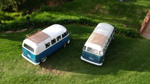 Aerial view of two blue 1960s Vintage Volkswagen Kombi Vans available for hire for weddings, birthdays and special events