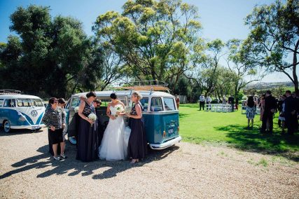 Bride & bridesmaids preparing themselves in front of Volkswagen Kombi Van for Hire at Wedding Ceremony in VW Kombi Van Photo Gallery