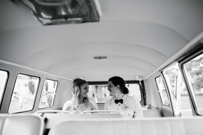 Bride & Groom on their Wedding Day in the back of hired Vintage VW Kombi Van Black & White Shot