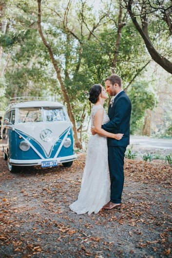Bride & Groom hugging in front of hire car, VW Kombi Van in Adelaide, South Australia on their Wedding Day VW Kombi Van Photo Gallery Kombi Cruise