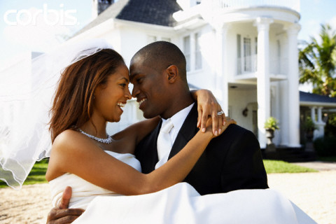 Happy Newlyweds in Front of Mansion