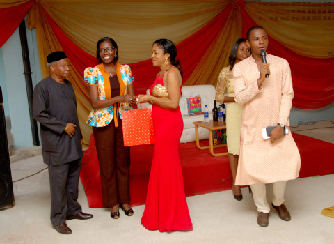 The first prize winner, Mrs. Modupe Ehirim receives her prize from Mr and Mrs Okonkwo.