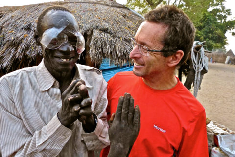 """Dr. Tabin celebrates with once """"Blind Leper"""" in Duk Payuel; Photograph by Jordan Campbell Source: adventureblog.nationalgeographic.com"""
