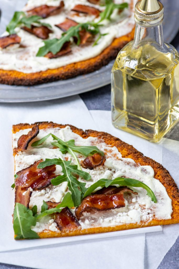 SIMPLE SWEET POTATO PIZZA CRUST with whipped goat cheese, bacon, and arugula