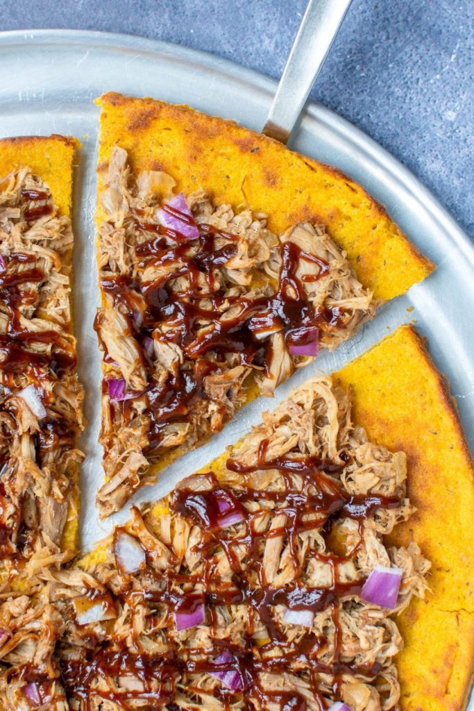 SWEET POTATO OAT FLOUR PIZZA CRUST with pulled pork, red onion, and barbeque sauce is one of the best uses ever for leftover pulled pork. Dairy-free. | KookyPizza.com | #pulledpork #dairyfreepizza