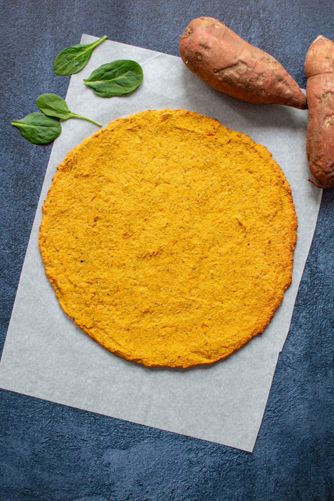 SWEET POTATO OAT FLOUR PIZZA CRUST - Sweet potato fans will love the subtle sweet flavor in this hearty pizza crust. Fantastic topped with pork, chicken, or turkey. Gluten-free, dairy-free, no added sugar. | KookyPizza.com | #pizzacrust #sweetpotato #sweetpotatoes