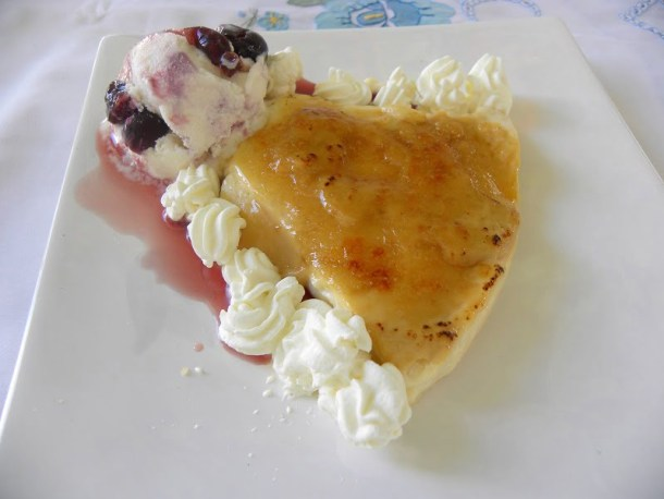 Baked caramelized rice pudding with ice cream image