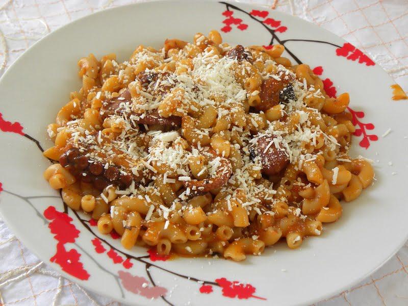 Htapodi (or moschious) me Makaronaki kofto (Octopus in tomato sauce with pasta)
