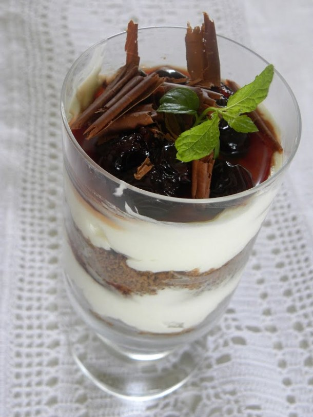 cheesecake with sour cherries in a glass image
