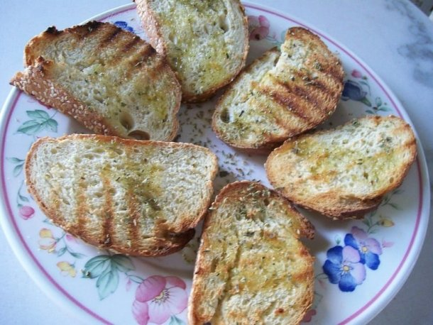 Bread with ladolemono and rigani image