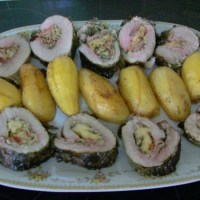 Roasted Pork stuffed and wrapped in vine leaves