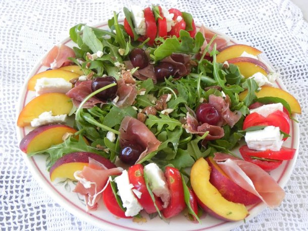 Rocket caprese salad with nectarines image