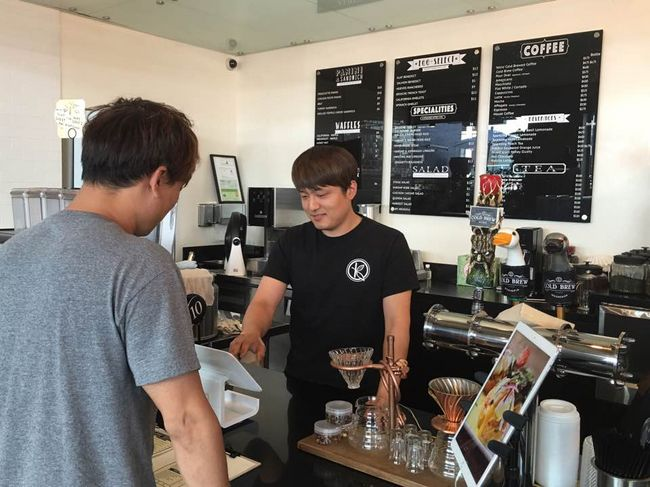 Increasing demand for higher quality coffee has drove up its price over the last couple of years. The picture above shows a customer making an order at Koreatown café Klat.