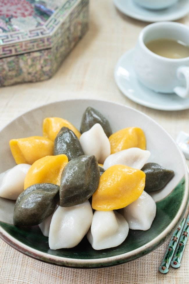 Korean half-moon shape rice cakes in yellow, green and white colors