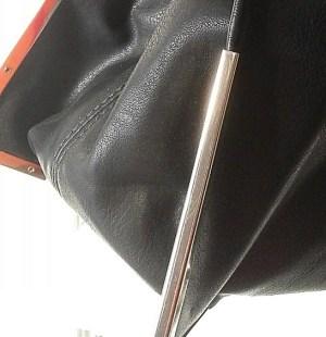 naisten-musta-muotilaukku