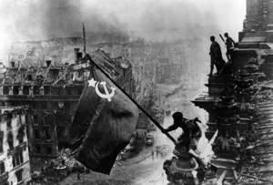 Raising_a_flag_over_the_Reichstag