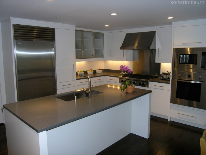 Modern White Kitchen Cabinetry And Sleek Island New Canaan Ct