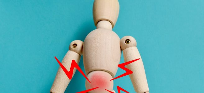 back pain in a posable wooden doll