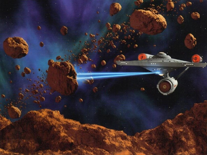 StarTrek_starship_Enterprise_NCC1701A_firing_phasers_freecomputerdesktop_wallpaper_1024