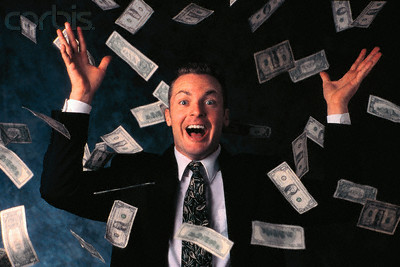 Businessman Throwing his Money Around