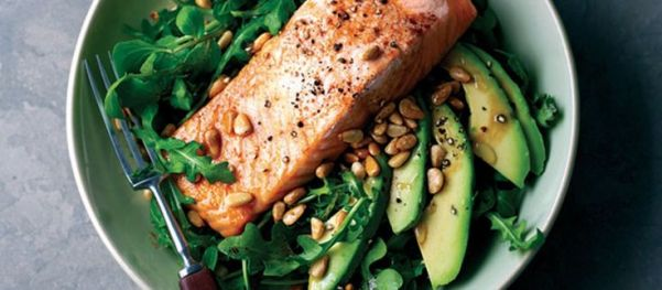 Grilled salmon with rocket avocado and pine nut salad