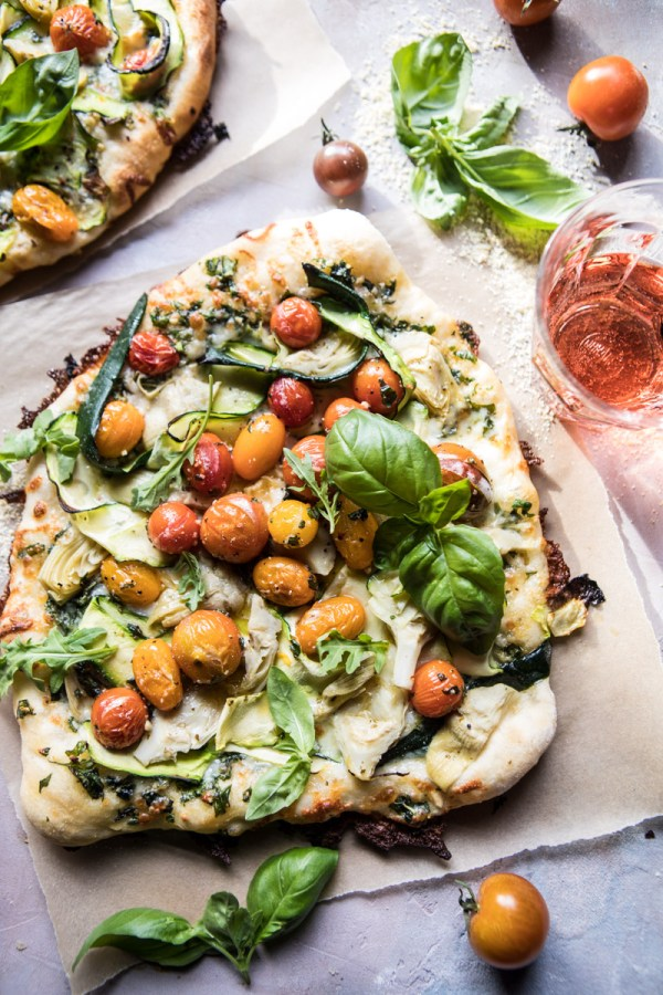 Burst Cherry Tomato, Artichoke, and Zucchini Pesto Pizza.
