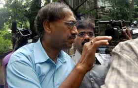 Mumbai Income Tax Commissioner being arrested in 2011