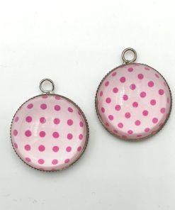 Metalen bolle bedel rond roze met stippen 25x21x8mm