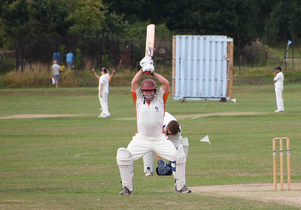 Fifty ... Gilo celebrates against Mottingham CC