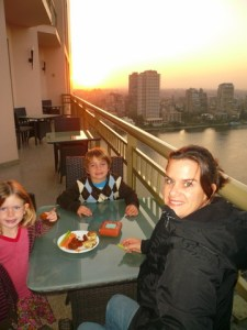 Because we were in an executive room, we were able to partake in the sunset complimentary cocktail hour.  The hotel was perfectly set over the Nile.  And, it was chilly--as you can see by the coat!