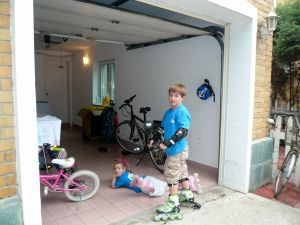 The garage is replete with goods: bikes, rollerblades, balls, hula hoops, or and a washer and dryer!