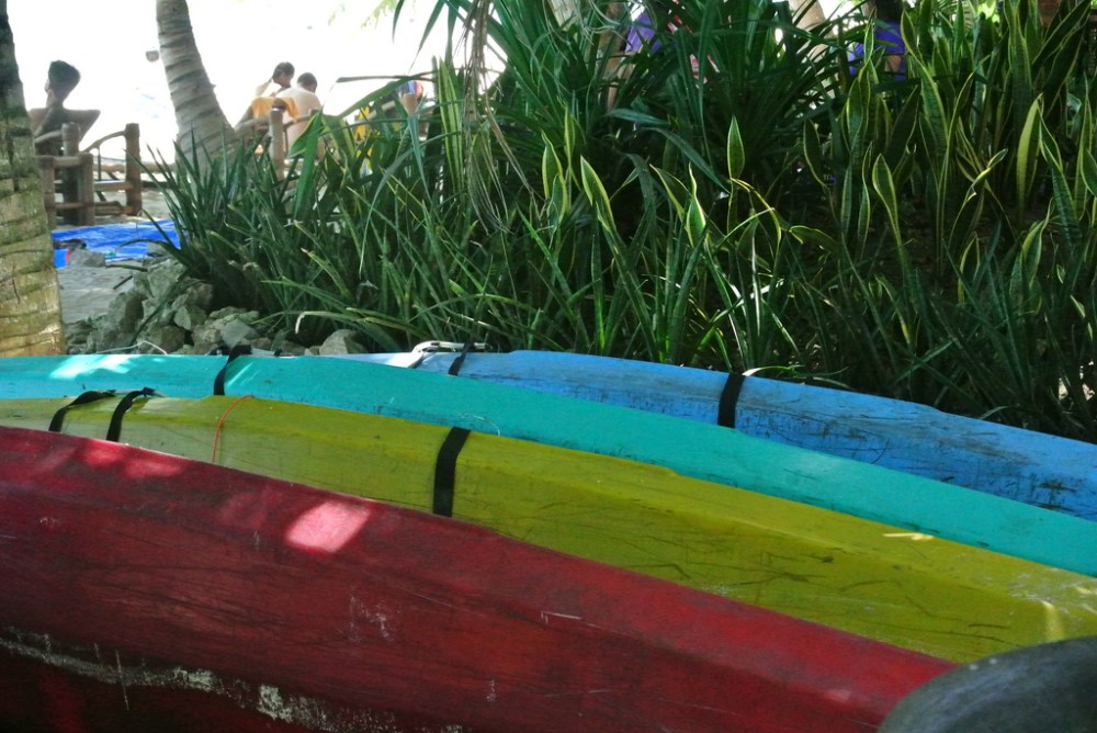 Each day, we'd see these colorful boats right out our door.